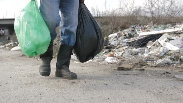Thumbnail for Male Legs Walking at Garbage Dump with Trash Bags