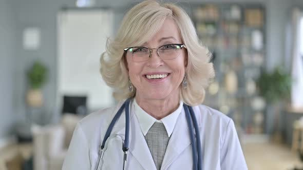 Thumbnail for Portrait of Smiling Old Female Doctor