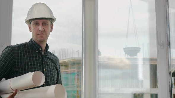 Thumbnail for Engineer or architect holding blueprint and looking at the camera.