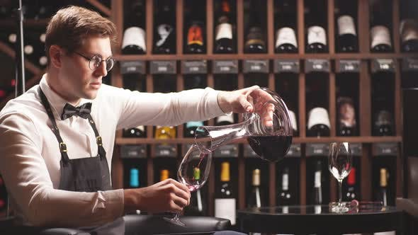 Thumbnail for Skilled Sommelier Pouring Wine From Decanter Ino Wine Glass