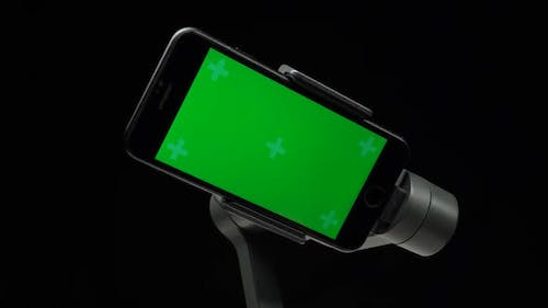 Steadycam Gimbal Stabilizer with Green Screen on Smartphone Is Rotating