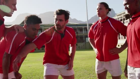 Team of rugby players planning their tactics on the rugby ground 4k