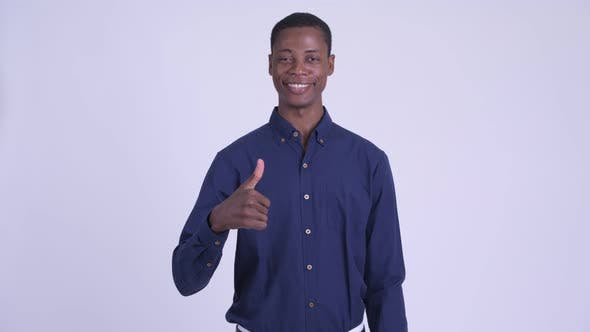 Young Happy African Businessman Giving Thumbs Up