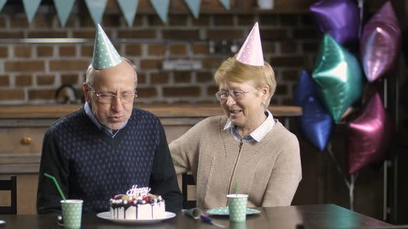 Thumbnail for Senior Couple Celebrating Birthday at the Table