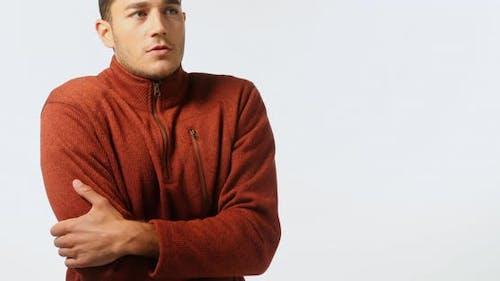 Man in sweatshirt feeling cold 4K 4k