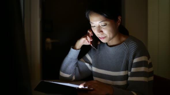Thumbnail for Woman use of digital tablet computer at night
