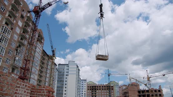 Thumbnail for Crane Lifts the Load and Rotate at Building Construction Site, Architecture Apartments. Wide Shot