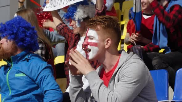 Thumbnail for Young Male Fan Screaming to Support Team at Sports Match