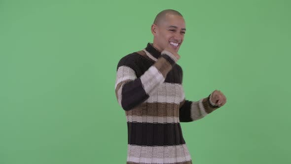 Thumbnail for Happy Bald Multi Ethnic Man Dancing Ready for Winter