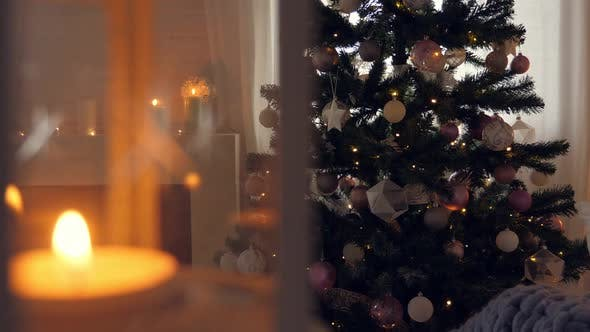 Thumbnail for Burning Candles. Christmas Celebration in Cozy Interior with Decorated New Year Tree