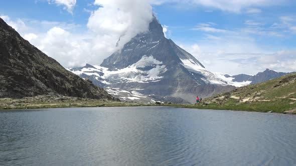 Thumbnail for Scenic view on snowy Matterhorn peak and lake Stellisee, Zermatt