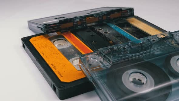Cover Image for Four Audio Cassettes Rotate on White Background