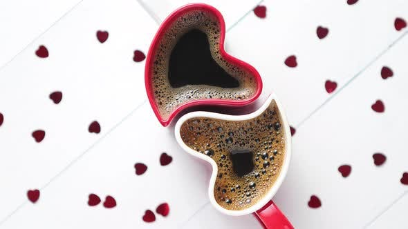 Thumbnail for Two Heart Shaped Coffee Cups Conected with Each Other.