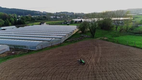 Thumbnail for Overhead Shot of Tractor Plowing