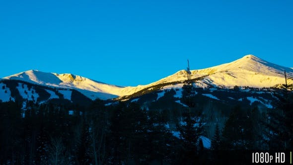Thumbnail for Time Lapse of Snow Covered Rocky Mountain Range at Sunrise