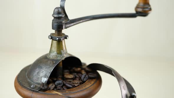 Thumbnail for Coffee Beans and Vintage Wooden Grinder