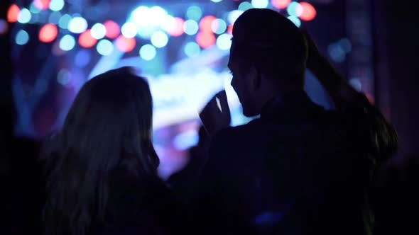 Thumbnail for Happy Woman and Man Waving Hands and Dancing at Music Festival, Nightlife