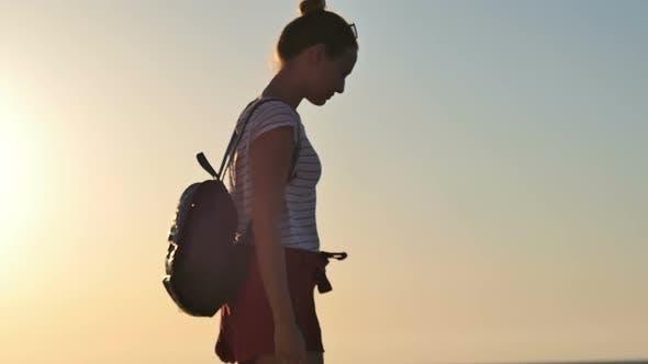 Thumbnail for Young Woman Enjoying Beautiful Sunset on the Beach