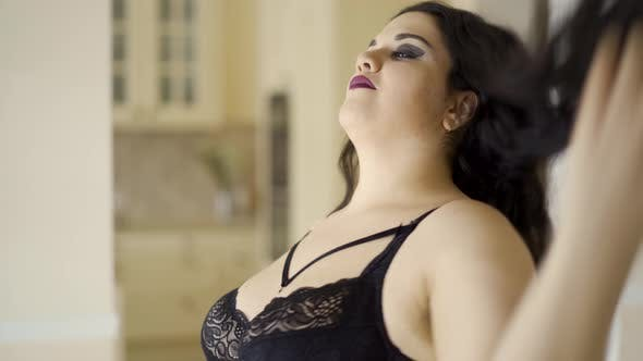 Thumbnail for Portrait Pretty Plump Girl with Long Hair and Black Bra Posing at the Camera