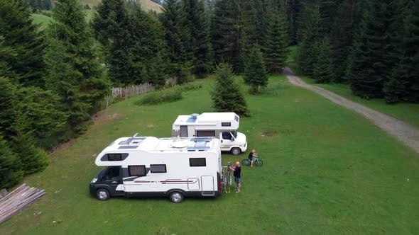 Camper Cars On Vacation In Mountain Area