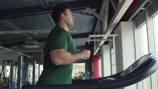 Thumbnail for Caucasian Man Training at Gym, Running on Treadmill, Side View