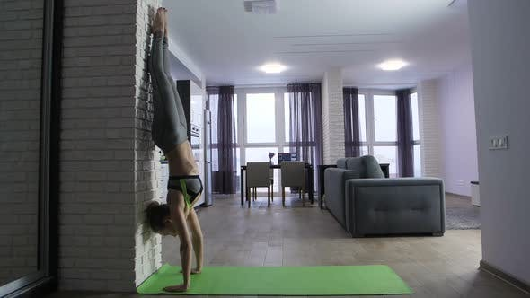 Thumbnail for Young Fit Woman Doing Handstand Near Wall at Home