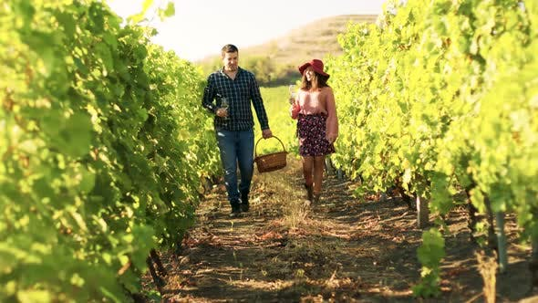 Beautiful Caucasian Couple with Glasses of Wine in Hands