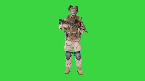Soldier Changing Clip Bullets Automatic Rifle While Walking Green Screen Chroma Key