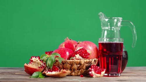 Pomegranate Juice and Pomegranates in Basket Rotate Slowly.