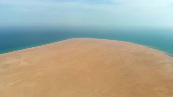 Aerial Vast Desert Sands Adjacent to the Sea by the Water