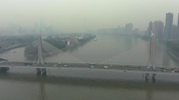 Cover Image for Bridge in Guangzhou City in Smog, Car Traffic and Cityscape. China. Aerial View