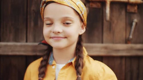 Cute Little Girl Posing for Camera in Greenhouse Farm