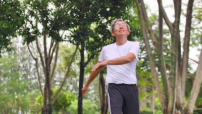 Asian senior man exercising in the park