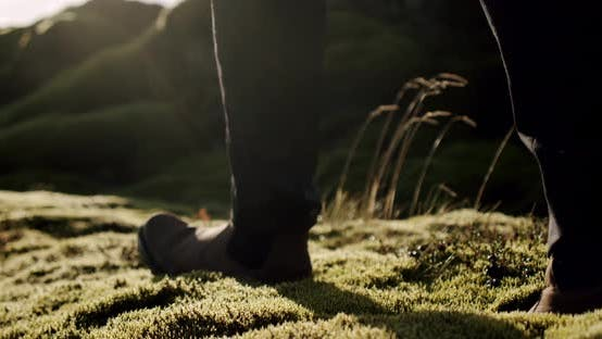 Thumbnail for A Close Up View of a Man Legs in Brown Boots Walking on Green Moss and Grass in Iceland