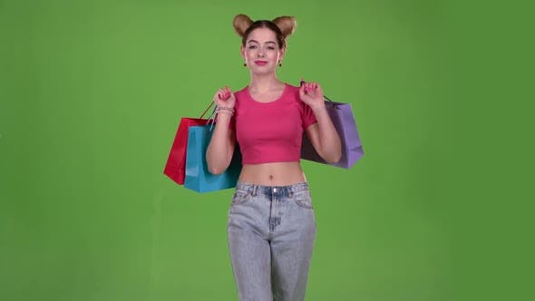 Thumbnail for Teenager Goes Shopping with Bags in His Hands. Green Screen