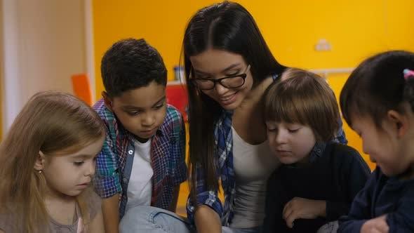 Teacher and Kids Learning in Preschool Class
