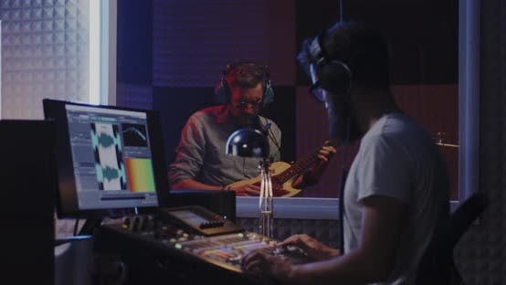 Thumbnail for Guitarist and Sound Engineer Working in Studio
