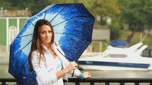 Thumbnail for Beautiful Girl Posing With Umbrella