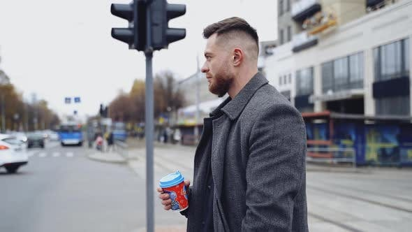 Handsome man on urban background. Profile of a young businessman
