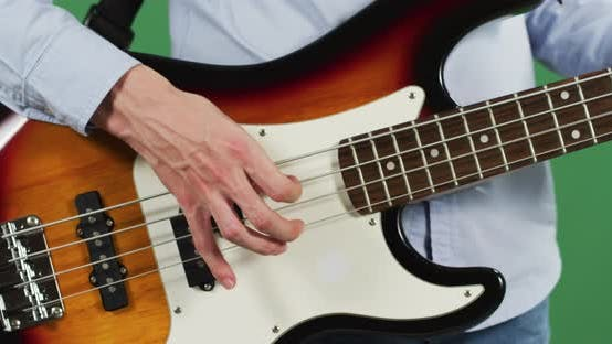 Thumbnail for Fingers strumming an electric guitar