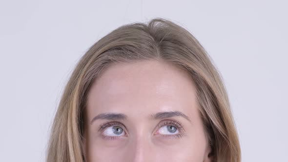 Eyes of Young Woman with Blond Hair Thinking