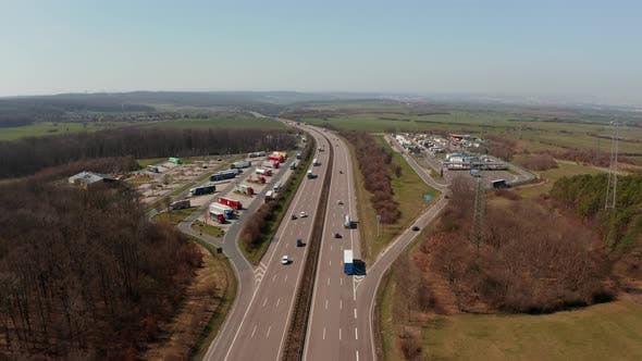 Forwards Tracking Car Turning Onto Petrol Station From Multilane Highway Autobahn in Germany