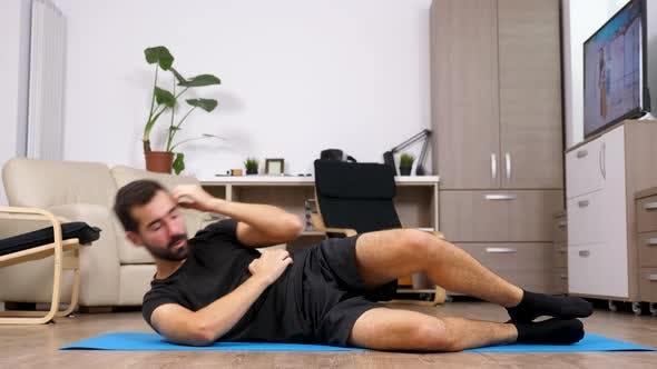 Cover Image for Man on His Rear Side Doing Exercises for the Abs