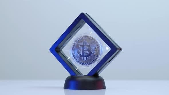 Shiny golden bitcoin isolated on white background