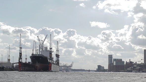 Thumbnail for Cargo Ship In Hamburg Port Bright Clouds
