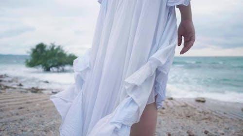 Slow motion close up legs of sad broken heart woman on beach