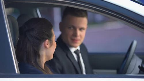 Handsome Man Hugging Pretty Woman in Car After Date, Romance and Sweetness