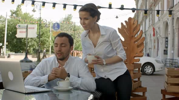 Thumbnail for Businessman and Businesswoman on Video Conference with Them Colleague in Cafe