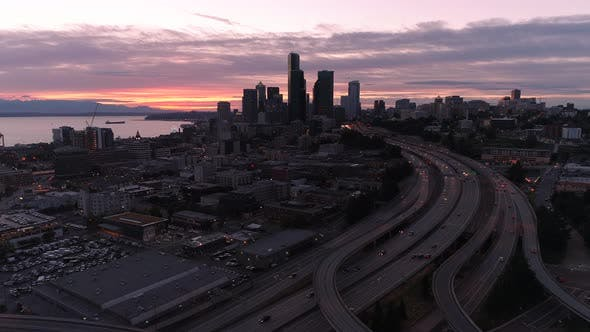 Cover Image for Aerial Hyperlapse Of Sunset On Downtown Seattle Skyline With City In Motion Moving At High Speed