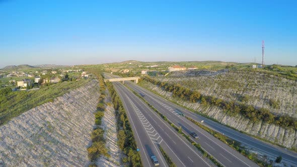 Thumbnail for Cars Driving on Modern Highway. Aerial Shot of Traffic. Video Filmed With Drone